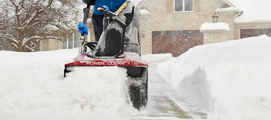 Snow blower clearing a driveway from Newmarket Mower