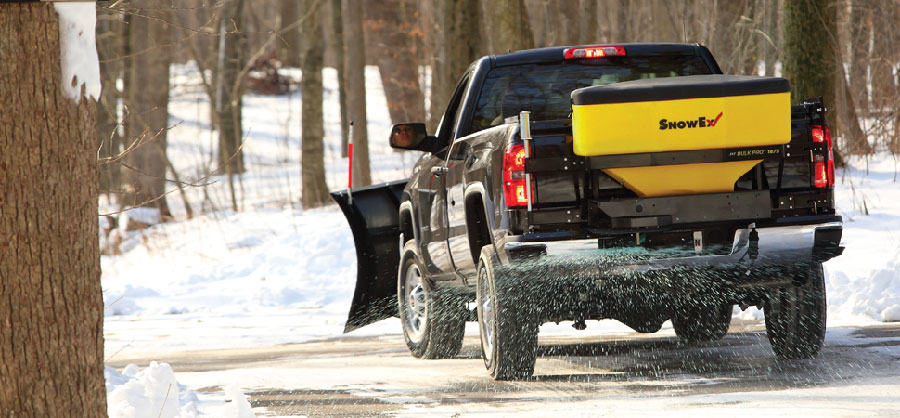 SnowEx Salt Spreader salting a road available at Newmarket Mower
