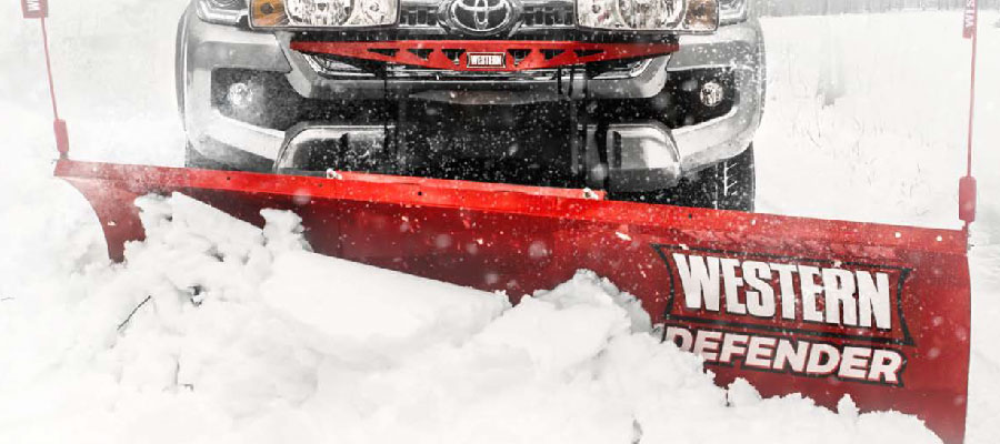 Western Snow Plow available at Newmarket Mower clearing a road